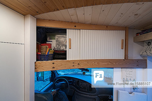 Cupboard over the campervan driving cabin with sliding doors.