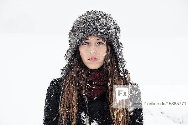 Portrait of serious young woman in winter