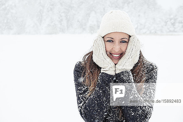 Portrait of smiling young woman in winter landscape