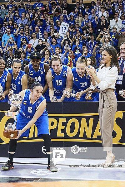 Queen Letizia of Spain hands Silvia Dominguez of Perfumerias Avenida the Queen Cup trophy during 'Spanish Queen's Cup' Basket Final match between Perfumerias Avenida (winner) and Uni Girona at Pabellon Multiusos Sanchez Paraiso on March 8  2020 in Salamanca  Spain