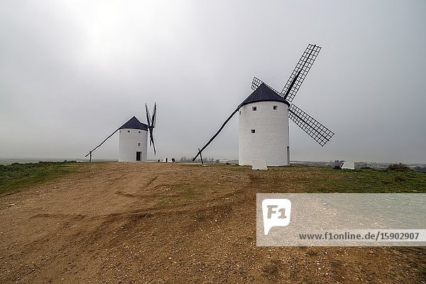 Two windmills at Temblque in winter time. Toledo. Spain. Europe.