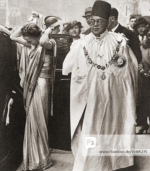 EDITORIAL The Aga Khan III with his wife Begum Om Habibeh Aga Khan  seen here at the coronation of George VI and Queen Elizabeth  1936. Sir Sultan Mahomed Shah  Aga Khan III  1877-1957. 48th Imam of the Nizari Ismaili religion. Begum Om Habibeh Aga Khan  1906-2000. From The Coronation Souvenir Book  published 1937.