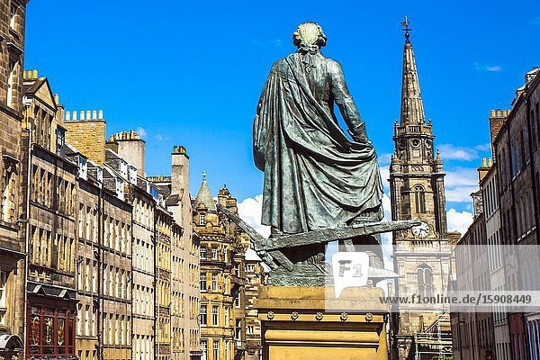 Adam Smith Statue  The Tron Kirk church on background  Royal Mile  High Street  Old Town  Edinburgh  Scotland  United Kingdom  Europe.