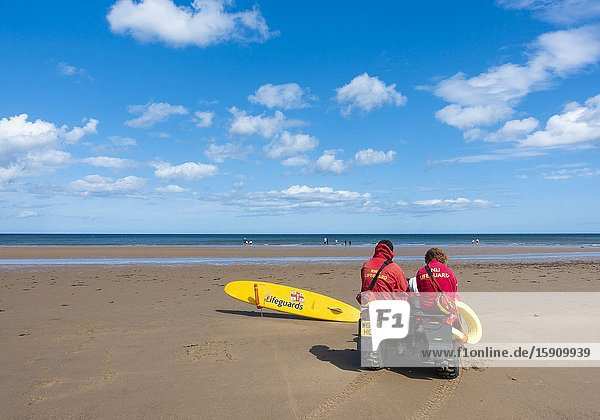 Lifeguards sitting on quad bike at Saltburn by the sea  North Yorkshire  England. United Kingdom.