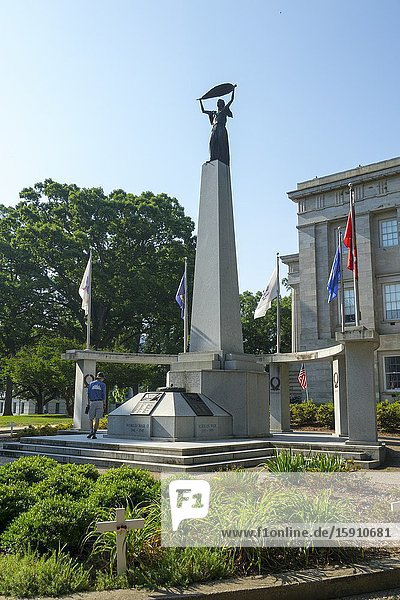 MEMORIAL TO VETERANS OF WORLD WAR I WORLD WAR II AND THE KOREAN WAR ERECTED 1990 Raleigh a city in NC North Carolina and current state capitol capital statehouse.