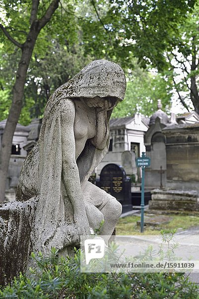 Stone statue personifying the ''Grief'' by Albert Bartholome adorning the tomb of Henri Majak (1831-1897) French librettist  Montmartre Cemetery (French: Cimetiere de Montmartre)  18th arrondissement  Paris  Ile-de-France region  France  Europe.