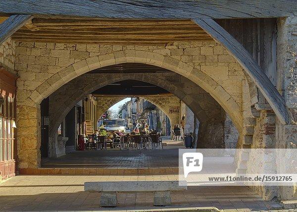Medieval archway in the Place de la Halle  Villereal  Lot-et-Garonne Department  Nouvelle-Aquitaine  France.