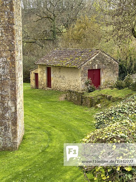 Stone outbuilding outside wall of medieval fortified village of Larressingle  Gers Department  Nouvelle Aquitaine  France.