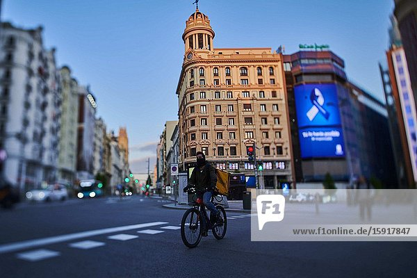 A biker at Callao Square and Gran Via Street during the confinement due to the national emergency caused by Covid-19 on April 12  2020 in Madrid  Spain.The day before workers on Spain they return theirs non-essential works