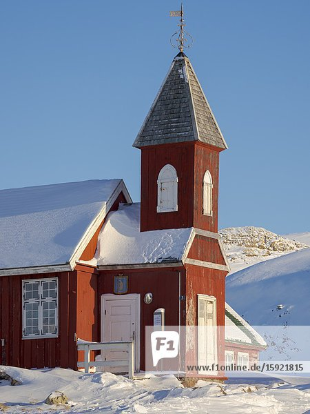 Museum and church located in buildings dating back to the founding of the colony. Winter in the town of Upernavik in the north of Greenland at the shore of Baffin Bay. America   Denmark  Greenland.