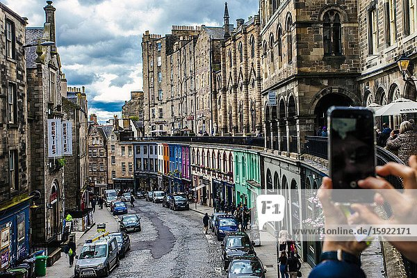 Taking a photo with the mobile to Victoria Street  Old Town  Edinburgh  Scotland  United Kingdom  Europe.