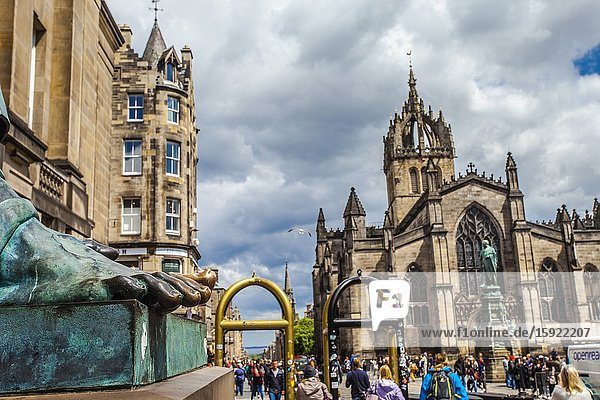 Foot of David Hume statue and St Giles' Cathedral  or the High Kirk of Edinburgh  Royal Mile  High Street  Old Town  Edinburgh  Scotland  United Kingdom  Europe.