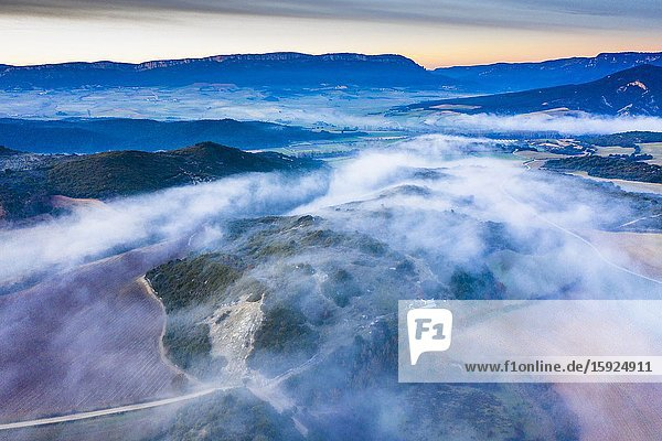 Agricultural area and fog. Aerial view. Ayegui area. Navarre  Spain  Europe.