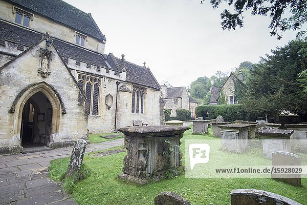 CASTLE COMBE WILTSHIRE ENGLAND ON OCTOBER 12  2019: Its one of the UK's prettiest villages. The parish church St Andrew..