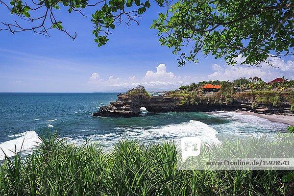 Sea arch at Tanah Lot Temple  Bali  Indonesia.