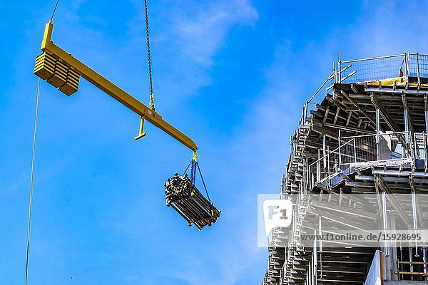 Crane hoiting up construction material at a construction site at Strijp-S  Eindhoven  The Netherlands.