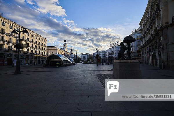 Empty streets and social distancing during the Coronavirus outbreak. Puerta del Sol with Oso and Madrono statue on April 29  2020 in Madrid