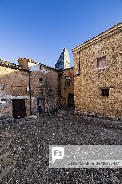 Typical street and ruins of the old tower at the medieval village of Maderuelo. Segovia. Spain. Europe.