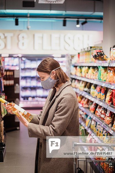 Woman with mask in supermarket.