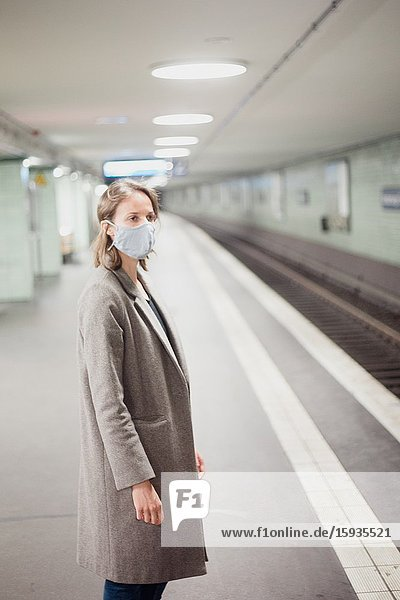 Woman using public transportation with mask during Corona days.