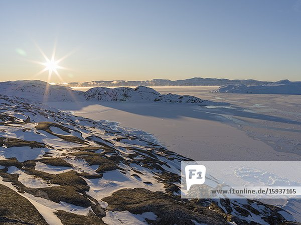 Sunrise during winter at the Ilulissat Icefjord  located in the Disko Bay in West Greenland  the Icefjord is part of the UNESCO world heritage. America  North America  Greenland  Denmark.