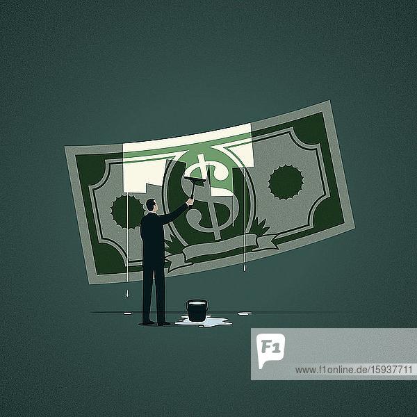 Businessman washing dollar banknote