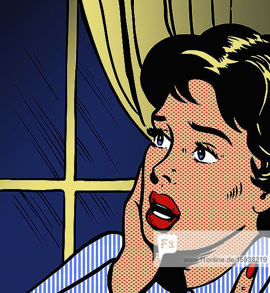 Frightened woman looking out of window at night