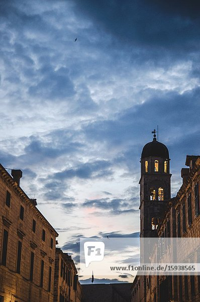 Birds flying around Franciscan Church and Monastery at Dusk  Dubrovnik  Croatia