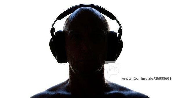 Silhouette of Man in Shaking Headphones
