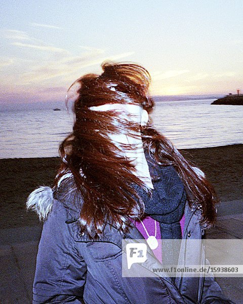 Young Adult Woman with Hair Covering Her Face on Windy Beach at Sunset  3D Stereo Effect