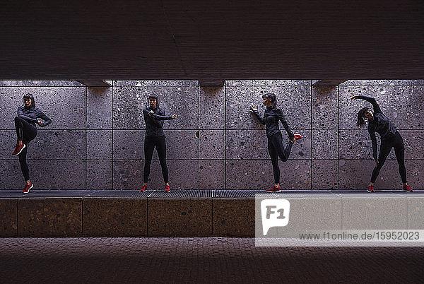 Weibliche Athletin wärmt sich vor dem Laufen in der Fussgängerunterführung auf