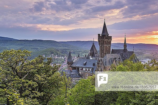 View of Wernigerode Castle at sunset  Wernigerode  Harz Mountains  Saxony-Anhalt  Germany  Europe View of Wernigerode Castle at sunset, Wernigerode, Harz Mountains, Saxony-Anhalt, Germany, Europe