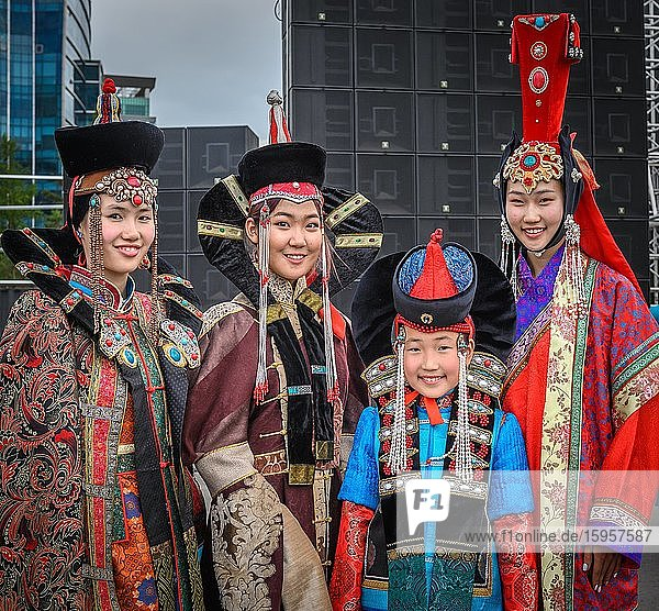 Young females wearing Mongolian traditional costumes and posing in the Central square during the DEEL festival (national dress)  Ulaanbaatar capital city  Mongolia  Asia