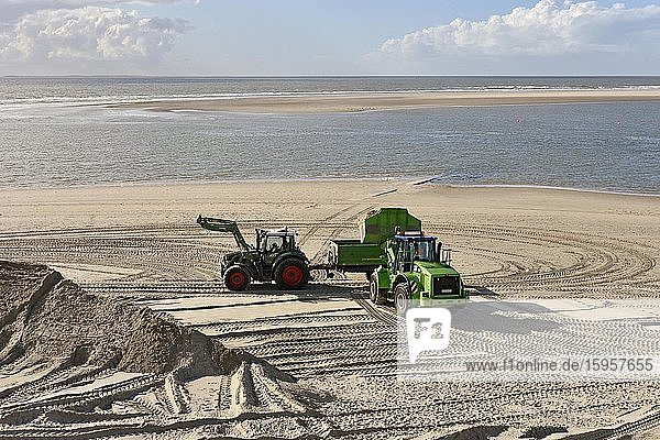 Working at the beach  sand is distributed with tractor at the beach  Borkum  East Frisian Island  Lower Saxony  Germany  Europe