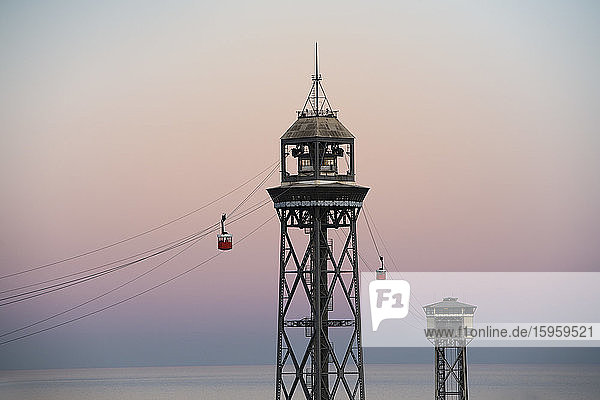 View of the Barcelona Cable Car at sunset  Catalonia  Spain.