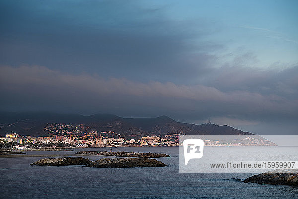 Distant view of Barcelona harbour at sunset  Catalonia  Spain.
