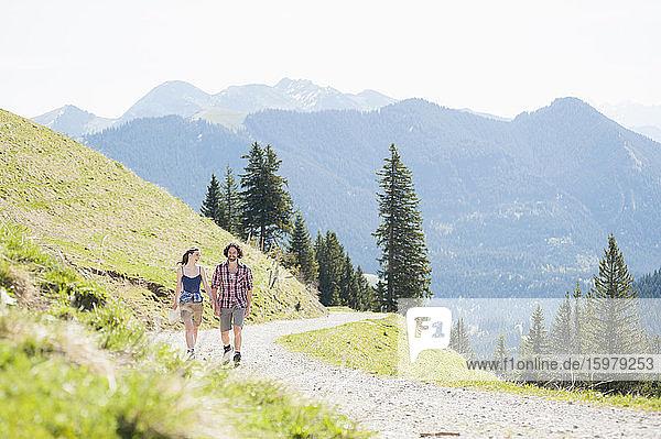 Hiking couple on hiking trail in summer  Wallberg  Bavaria  Germany