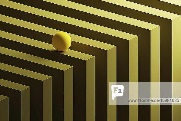 Three dimensional render of small yellow sphere rolling over geometric pattern