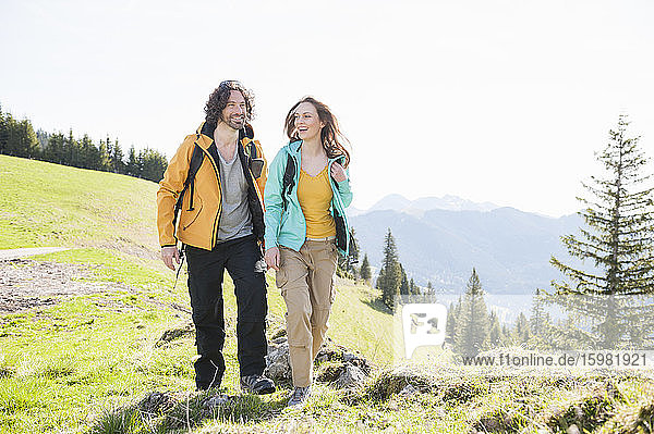 Hiking couple laughing  Wallberg  Bavaria  Germany