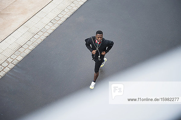 Young man jogging with headphone