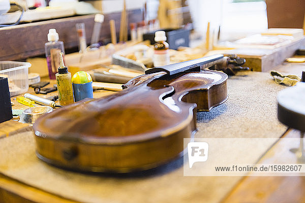 Violin making  violin on workbench Violin making, violin on workbench