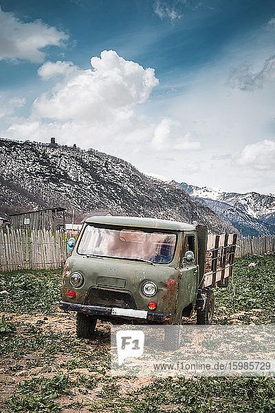 Georgia  Svaneti  Ushguli  Old truck parked in front of mountain village