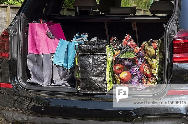 Shopping bags and the weekly shop in boot of a car  Hampshire  England  UK.