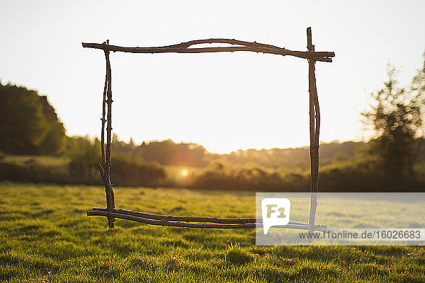 Wood stick frame overlooking sunny tranquil rural view