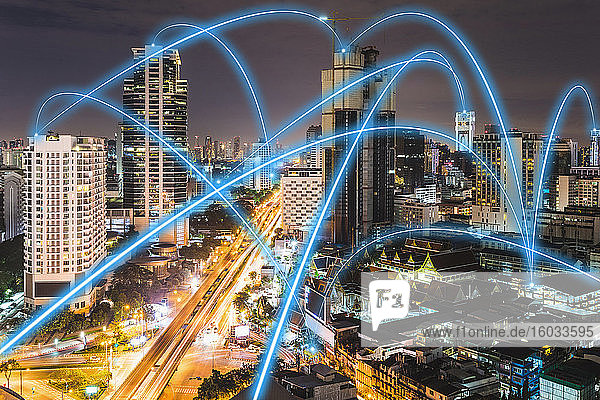 5G connectivity  blue connections crisscrossing the  skyline of Bangkok  Thailand at night.