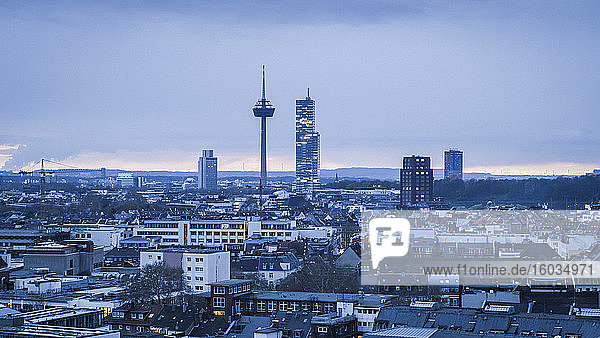Colonius TV Tower above Cologne cityscape at dusk  Germany