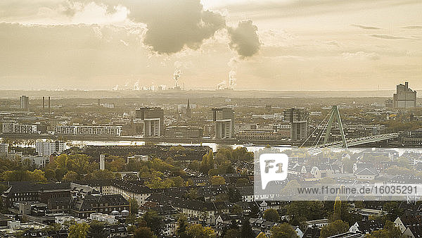 Smoke rising from factory behind Cologne cityscape  Germany