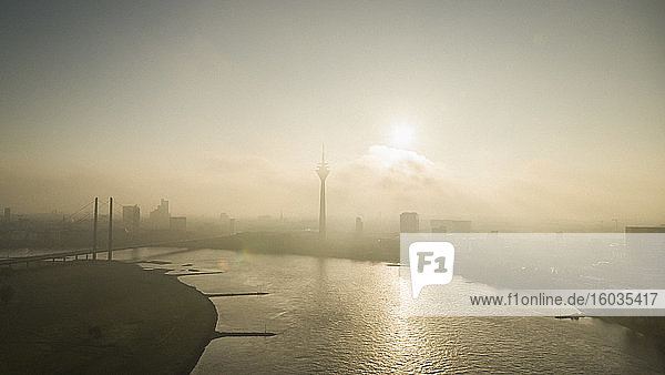 Sunset over silhouetted Duesseldorf cityscape and Rhine River  North Rhine-Westphalia  Germany