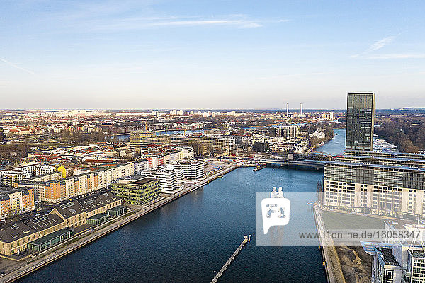 Germany  Berlin  Aerial view of Molecule Man sculpture standing in middle of river Spree canal