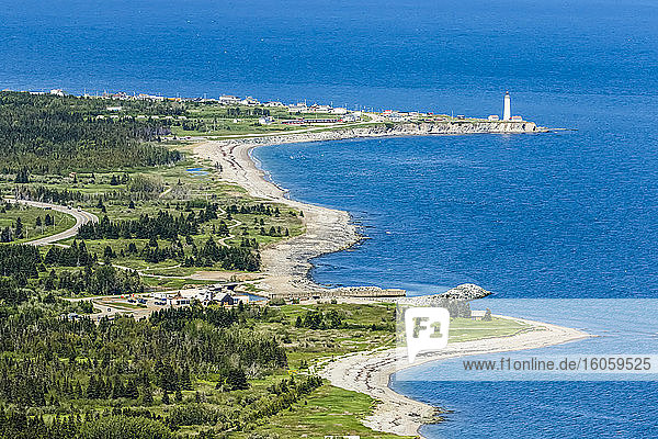 Seashore and Cape des Rosiers lighthouse; Gaspe  Quebec  Canada